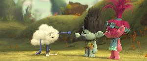 TRL_sq1250_s44_pub_f179_2K_final_RGB_FIN – From left: Cloud Guy (voiced by Walt Dohrn), a mysterious cloud-shaped inhabitant of the forest surrounding Troll Village, offers Branch (voiced by Justin Timberlake) and Poppy (voiced by Anna Kendrick) a fist bump in DreamWorks Animation's TROLLS. Photo Credit: DreamWorks Animation.